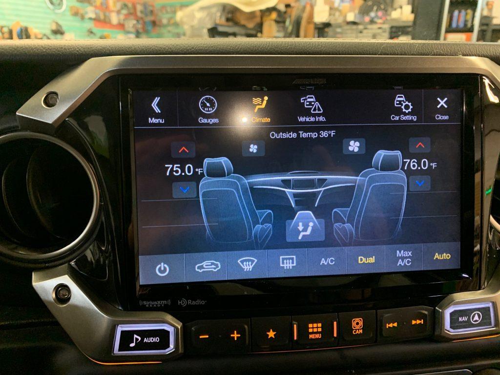 Alpine X409-WRA-JL retains OEM HVAC controls and display.